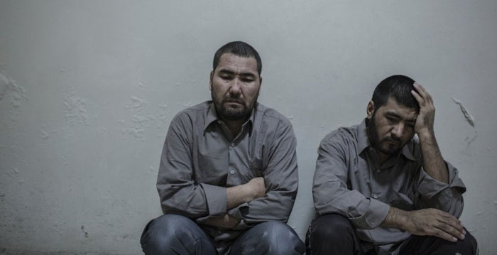 Murad Ali Hamidi (left) and Said Ahmed Hussein were captured by rebel forces after storming a building in Aleppo, led  by an Iranian officer. Syria