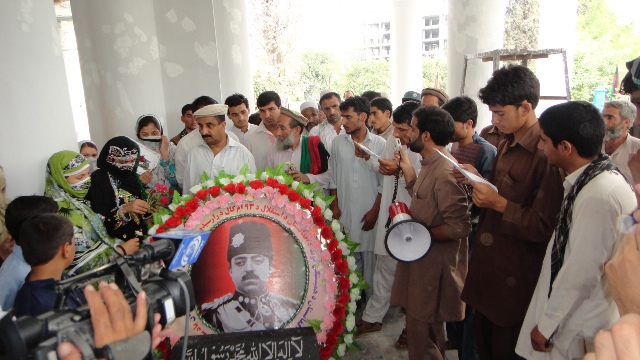 Members of the Solidarity Party of Afghanistan place flowers on the tomb of King Amanullah Khan in Jalalabad